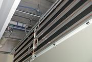 Copper coils in ceiling tiles are part of a radiant cooling system that will help keep workers comfortable at the Edith Green-Wendell Wyatt federal office building.