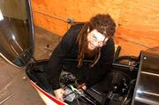 Brad Davis, an EcoSpeed engineer, works on a velomobile installation.