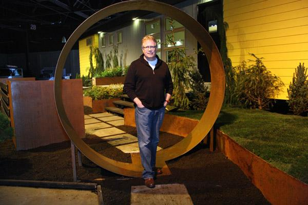 """Ideabox's Jim Russell shows off the dramatic entrance to """"Aktiv,"""" the prefabricated home designed to be outfitted entirely by Ikea. It's on display this week at the Portland Home and Garden Show."""