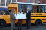 The big check. Left to right: Rick Wallace, senior energy analyst, Oregon Department of Energy; Teri Brady, interim director of student transportation, Portland Public Schools; and Cal Hull, senior vice president, First Student Inc.