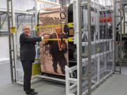 CEO Tim Harris emphasized the efficiency of SoloPower's roll-to-roll manufacturing process. Each roll of steel plating is one meter wide and 6,000 feet long and results in 200 kilowatts in solar cells at the end of the manufacturing process.
