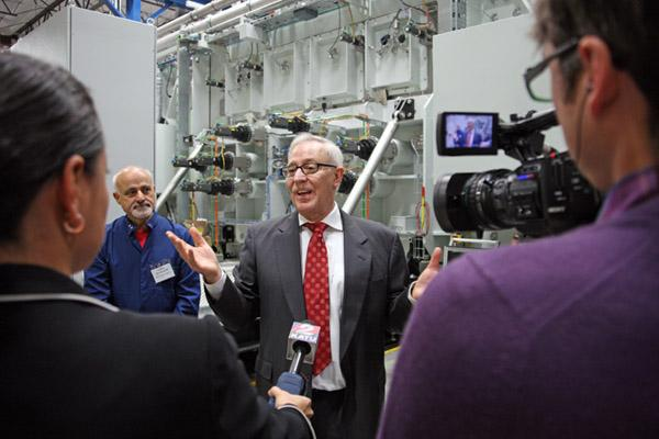 SoloPower CEO Tim Harris welcomed the media to his company's first full-scale production facility Thursday. He expects the site to be operating two full manufacturing lines when it's fully built out.