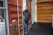 Siteworks' Jean-Pierre Viellet  shows off the doors from the shipping container which lead into the Brainstorm Room where 14-foot ceilings and a magnetized white board facilitate big ideas.