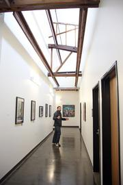 A bright hallway leads from ISITE's offices to a cafe space and additional office space on the south side of the building.