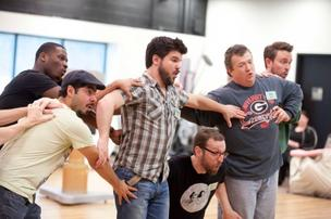 Members of The Atlanta Opera Chorus rehearse a scene as Oompa-loompas in the Atlanta Opera's upcoming production of The Golden Ticket, a comic opera based on Roald Dahl's classic children's book Charlie and the Chocolate Factory, March 3-11, 2012 at the Cobb Energy Centre.