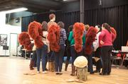 Members of the Atlanta Opera Women's Chorus shake their tail feathers.