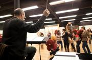 Conductor Peter Ash conducts a scene in which Veruca Salt (mezzo-soprano Abigail Nims) gets disciplined and whisked away by squirrels.