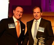 Justin Parsonnet with CBRE Inc. and David Allman with Regent Partners accept Office deal of the year award for the acquisition of Concourse Corporate Center.