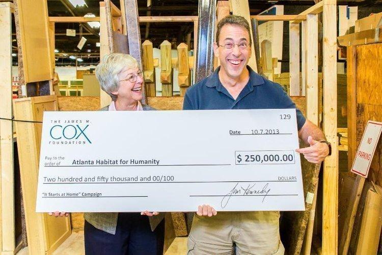 Clark Howard presents $250,000 on behalf of James M. Cox Foundation to Larrie Del Martin, president and CEO of Atlanta Habitat.