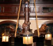 Wonderful appointments such as this heavily carved wood chandelier showing Oriental figures in boats will be sold