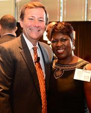 """William Pate, president and CEO of Atlanta Convention and Visitors Bureau and Leona Barr-Davenport, president and CEO of Atlanta Business League at the Chick-fil-A """"Home Office Backstage Tour"""" 2013"""