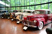 """Chick-fil-A's """"Home Office Backstage Tour"""" 2013:                 A collection of Truett Cathy's cars"""