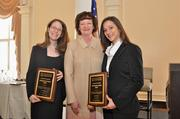 On behalf of the Public Interest Committee, Co-Chairs Mariel F. Sivley, (left), Georgia Law Center for the Homeless, and Haley A. Schwartz, (right) , Atlanta Legal Aid Society, Inc., accept a 2012 Atlanta Bar Association Distinguished Service Award.