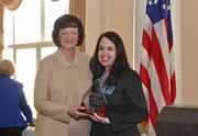 On behalf of the Women in the Profession Section, Section Chair Laura C. Zschach, Bodker Ramsey Andrews Winograd Wildstein, accepts the 2012 Small Section of the Year Award.