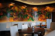 The decor incorporates artwork from Mexican artist Luis Sottil, along with a three-dimensional mural depicting native Atlanta bird species.