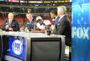 The Fox Sports team, Terry Bradshaw, left, Howie Long, interviewing Niners running back Frank Gore, with Michael Strahan and Jimmy Johnson.