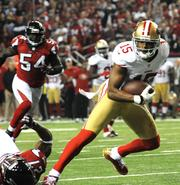 Niners wide receiver Michael Crabtree eludes Falcons defenders.