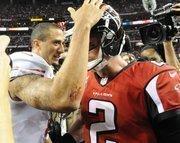 Niners quarterback Colin Kaepernick greets Falcons quarterback Matt Ryan after the game.