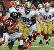 Falcons running back Jacquizz Rodgers tries to shake the Niners defense for a first down.