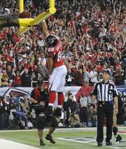 Tight end Tony Gonzalez celebrates what might have been his final touchdown.