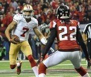 Niners quarterback Colin Kaepernick scrambles past Falcons cornerback Asante Samuel.