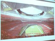 "A rendering of what the stadium could look like inside during a Falcons game. A unique feature is the circular ""video halo"""