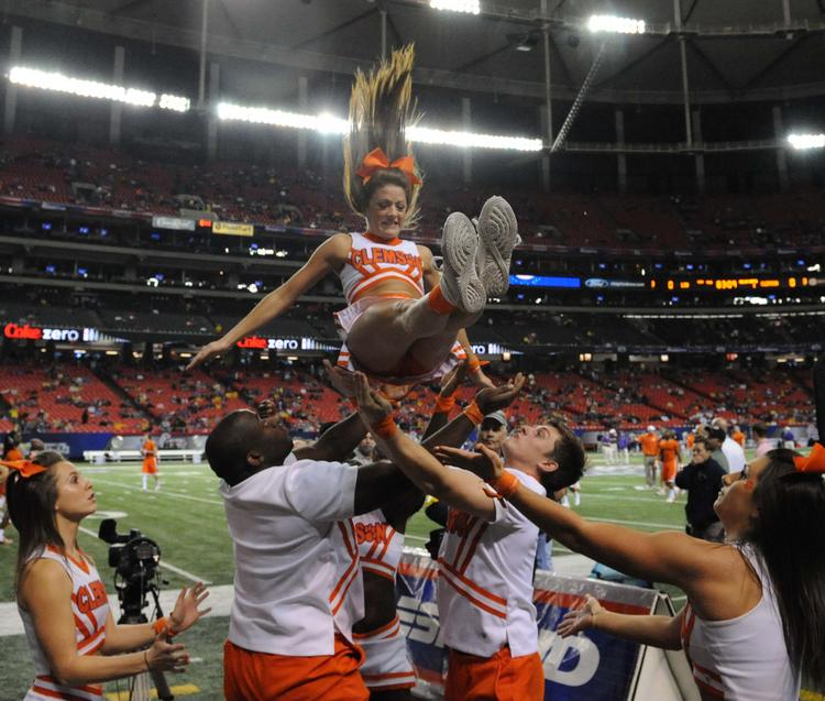 Clemson cheerleaders warm up before the game.