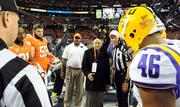 Chick-fil-A founder S. Truett Cathy flips the coin.