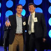 Josh Lieberman of KMS Technology accepts the Pacesetter award from Dan Campbell, CEO of Hire Dynamics. KMS ranked No. 5 on the 2012 Pacesetters list.