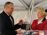 Yvonne Williams, president and CEO of Perimeter CIDs, gives Lt. Gov. Casey Cagle an award for helping win state funding for the project.