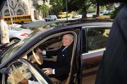 Gov. Nathan Deal takes a seat in a new Porsche parked on the capital steps.