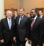 Gov. Nathan Deal, Porsche Cars North America President and CEO Detlev von Platen and  Atlanta Mayor Kasim Reed.
