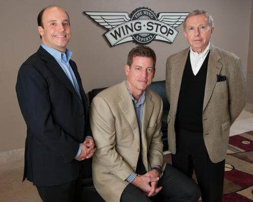 From left to right: Steve Romaniello, managing director of Roark Capital Group, Troy Aikman and Wingstop CEO Jim Flynn.