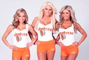 The new logo will begin appearing on Hooters Girl tanks tops over the next several months