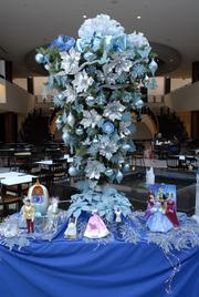 Four Corners of the World (retail kiosks in the food court) won the most votes for its tree.