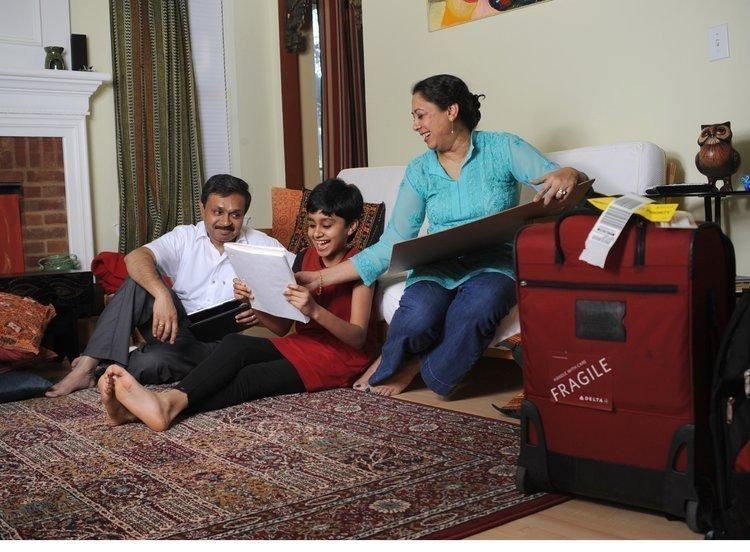 Umashankar Ramasubramanian, left, with his wife, Nandita Godbole, and their daughter. 'Uma' commutes to his job in Los Angeles.
