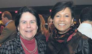 Alicia Philipp, left, and Shirley Mitchell of Bank of America at the 2011 Metro Atlanta Chamber annual meeting.