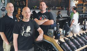 Good beer: Denny Young, Paul Saunders and Sean Galvin of The Beer Growler, which allows customers to pour a variety of craft beers into containers called growlers.