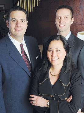 Money managers: John Inhouse, regional managing director of Merrill Lynch, from left; Alane Siem and John Tyers.
