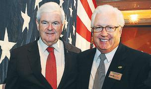 Newt Gingrich, left, and Ike Reighard of MUST Ministries at the Cobb Chamber of Commerce meeting on March 1, at Cobb Energy Performing Arts Centre.