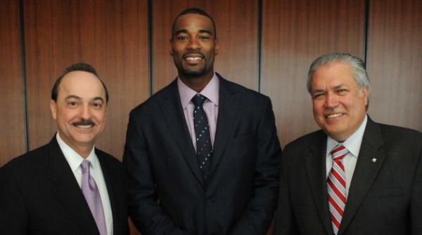 Ralph de la Vega, from left; Calvin Johnson Jr. of the Detroit Lions; and Ponce Duran of the Boy Scouts of America at the Peach of an Athlete awards banquet on March 20.