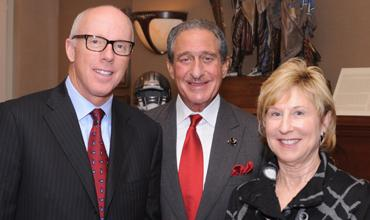 Winning ways: Rich McKay, Falcons president, Arthur Blank and Penny McPhee of the Blank Family Foundation.