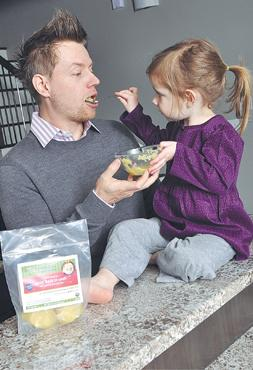 "Blazing a new path: Celebrity chef Richard Blais started making baby food when his daughter Riley, right, was born three years ago. Now he's developed ""Goin' Back to Cauli"" for organic baby food company Jack's Harvest LLC."