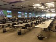 The media center is set up with wireless access, large screens, and hundreds of desks for credentialed journalists and photographers covering the race.