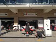 F1 teams are busy preparing for race weekend in the pit and paddock building.