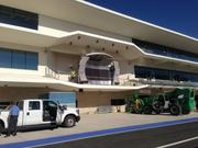 Finishing touches are being made to the winners podium on the pit and paddock building.