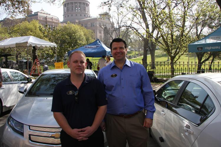 Capitol Chevrolet owner Thomas Harper, right, and sales consultant Roger Pillow in front of a Volt.