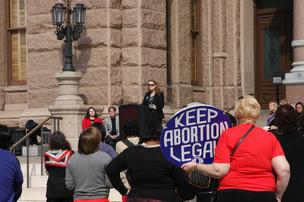 Heather Busby, executive director of NARAL Pro-Choice Texas, spoke outside the Capitol on Tuesday. Crowds gathered throughout the day near the south entrance to celebrate the 1973 Supreme Court ruling that made abortion a constitutional right.