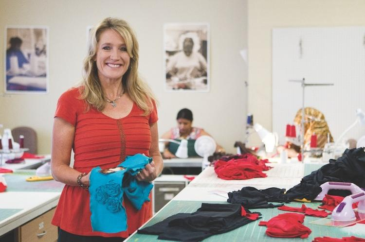 Leslie Beasley is the founder of Open Arms, a clothing company with a cause.
