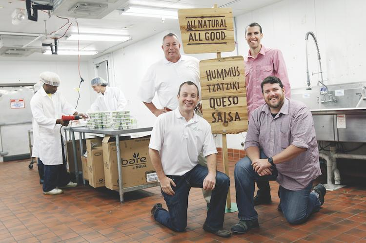 Zilks Foods President and co-owner John Anderson, front left, and Managing General Partner Bill McMeans, back left, have traded equity for services from Adam Butler, back right, and Marty Butler's agency.